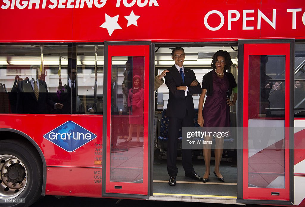 Wax figures of President Barack Obama and First Lady Michelle Obama arrive at Madame Tussauds wax museum after a ride through downtown in an open top bus.