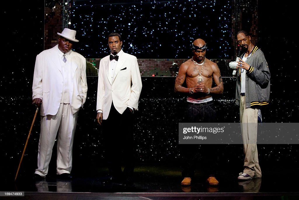 Wax figures of rap stars (L-R) Biggie Smalls (aka The Notorious BIG), P Diddy, Tupac Shakur and Snoop Dogg are exhibited for the first time together in London at Madame Tussauds on January 14, 2013 in London, England.