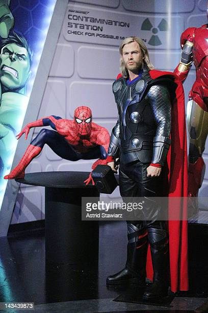 Wax figures of SpiderMan and Thor as portrayed by actor Chris Hemsworth appear at the Madame Tussauds New York's Interactive Marvel Super Hero...