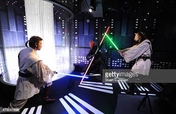 Wax figures of Star Wars characters Ben Kenobi Darth Maul and Qui Gon Yin on display at 'Star Wars At Madame Tussauds' on May 12 2015 in London...