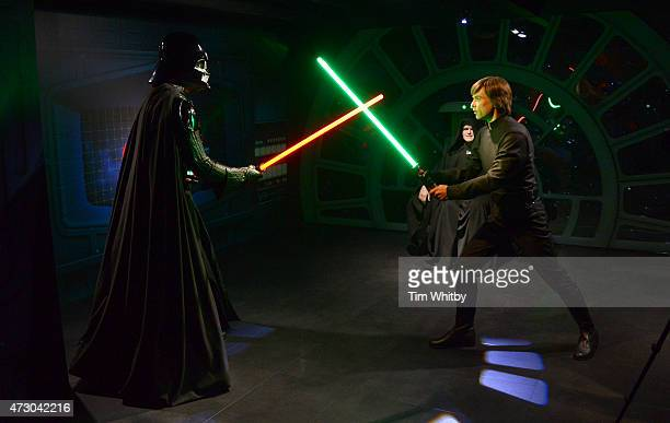 Wax figures of Star Wars characters Luke Sykwalker and Darth Vader on display at 'Star Wars At Madame Tussauds' on May 12 2015 in London England