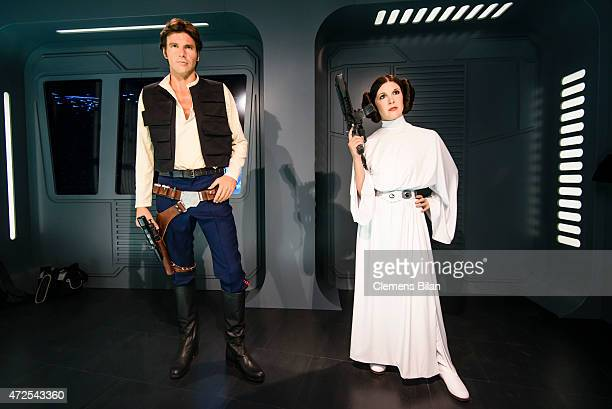 Wax figures of the actors Harrisson Ford as the Star Wars character Han Solo and Carrie Fisher in her role of Leia Organa are displayed on the...