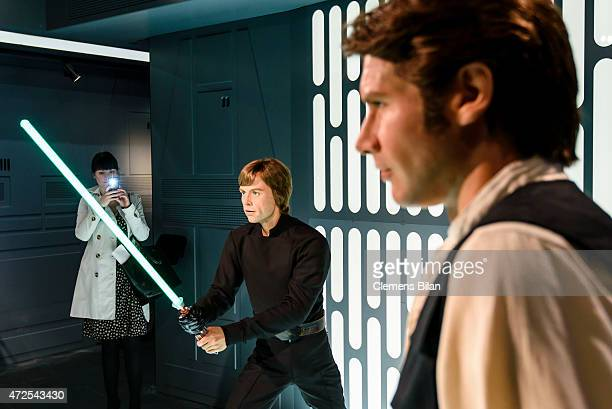 Wax figures of the actors Mark Hamill as the Star Wars character Luke Skywalker and Harrisson Ford as the Star Wars character Han Solo are displayed...