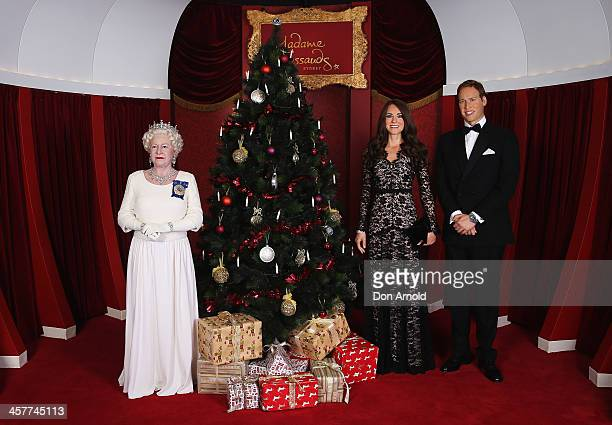 Wax figures of The Queen Princess Catherine and Prince William are seen at Maddam Tussauds on December 19 2013 in Sydney Australia