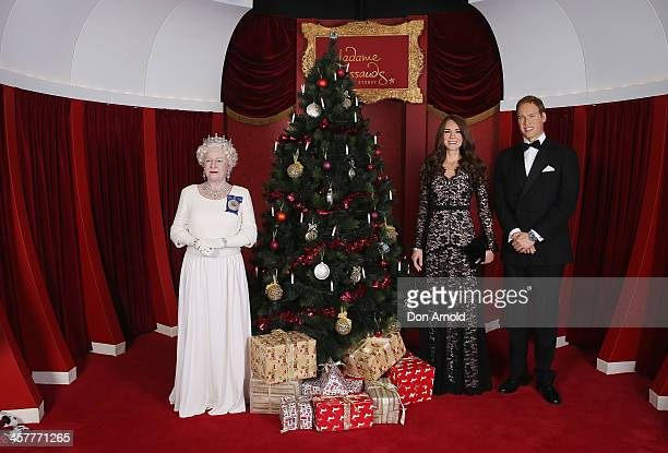 Wax figures of the Queen Princess Catherine and Prince William are seen displayed around a Christmas tree at Madame Tussauds on December 19 2013 in...