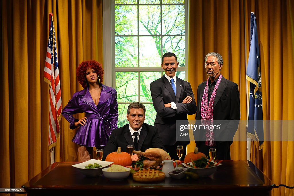 Wax figures of US musician Rihanna (L), actors George Clooney (2nd L) and Morgan Freeman (R) join US President Barack Obama (2nd R) in a recreation of the Oval Office for Thanksgiving at Madame Tussauds in London on November 21, 2012. AFP PHOTO/BEN STANSALL