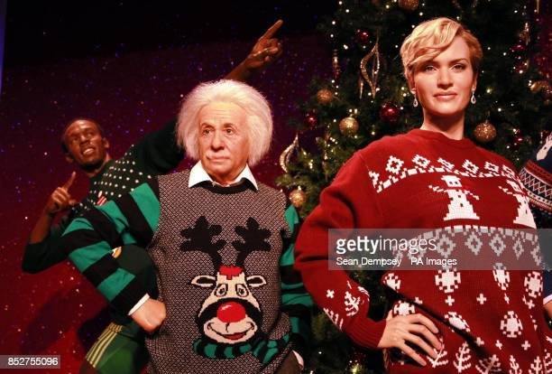 Wax figures of Usain Bolt Albert Einstein and Kate Winslet as they don Christmas sweaters to show their support for Save the ChildrenOtildes...