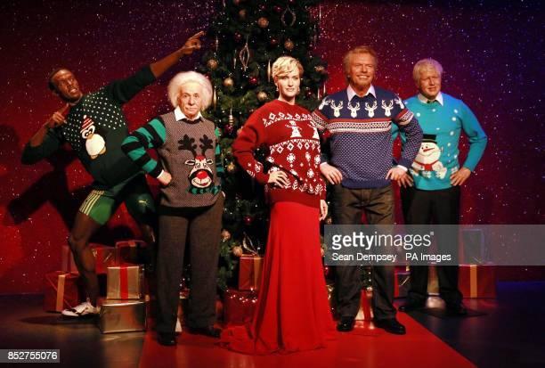 Wax figures of Usain Bolt Albert Einstein Kate Winslet Sir Richard Branson and Mayor of London Boris Johnson as they don Christmas sweaters to show...