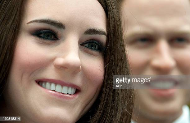 Wax likenesses of Britain's Prince William and his wife Kate stand at the British embassy in Berlin on August 16 2012 The wax figures will be on...