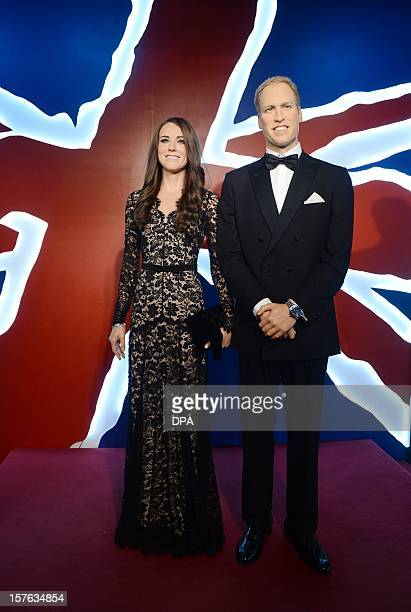 Wax likenesses of Britain's Prince William and his wife Kate stand at Madame Tussauds in Berlin on December 5 2012 AFP PHOTO / JENS KALAENE /GERMANY...
