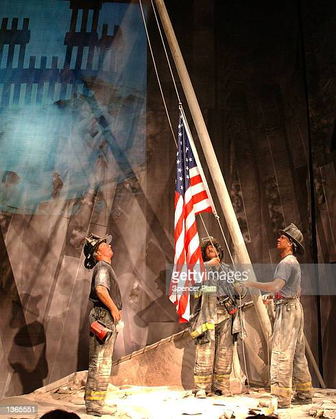 A wax replica of Thomas Franklin's photograph from September 11 is seen at Madame Tussaud's wax museum September 3 2002 in New York City The replica...