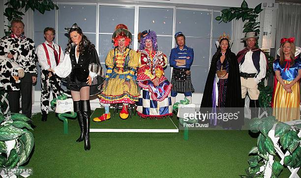 Waxwork models of George Bush and Tony Blair as the Pantomime Cow from Jack and the Beanstalk Victoria Beckham as Puss in Boots Ant and Dec as The...
