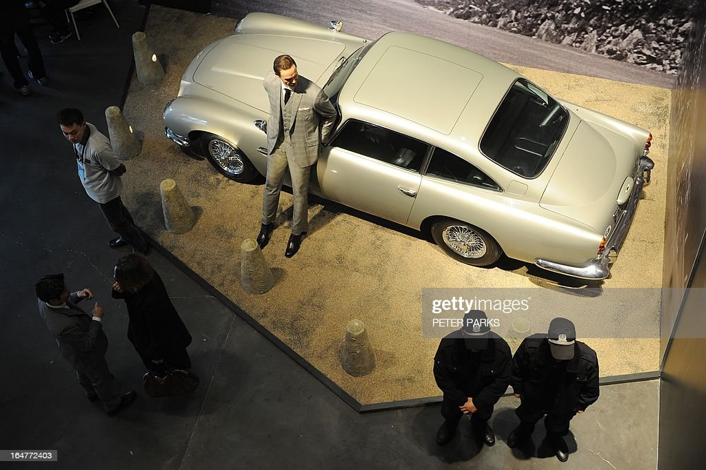 A waxwork of Sean Connery as James Bond (Top-L) stands next to a replica scale model of Bond's Aston Martin DB5 at an exhibition on the fictional British spy in Shanghai on March 28, 2013. The exhibition opened in Shanghai just weeks after the Communist government's censors cut parts of the latest film in the franchise, 'Skyfall' with a scene showing prostitution in Macau, a special administrative region of China, was removed, as was a line in which Bond's nemesis mentions being tortured by Chinese security agents. AFP PHOTO/Peter PARKS