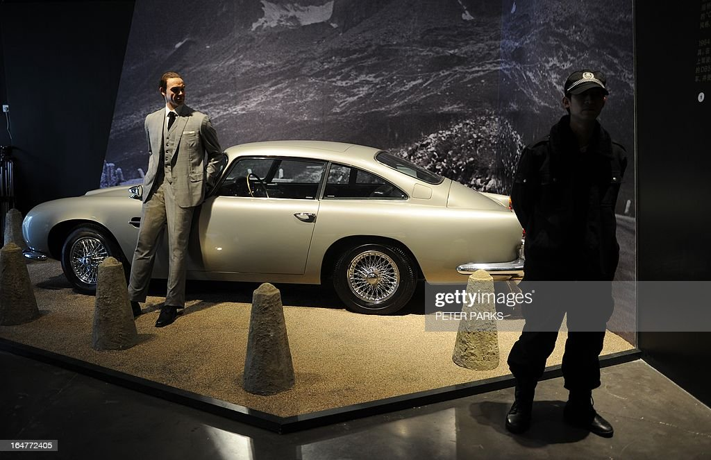 A waxwork of Sean Connery as James Bond (L) stands next to a replica scale model of Bond's Aston Martin DB5 at an exhibition on the fictional British spy in Shanghai on March 28, 2013. The exhibition opened in Shanghai just weeks after the Communist government's censors cut parts of the latest film in the franchise, 'Skyfall' with a scene showing prostitution in Macau, a special administrative region of China, was removed, as was a line in which Bond's nemesis mentions being tortured by Chinese security agents. AFP PHOTO/Peter PARKS