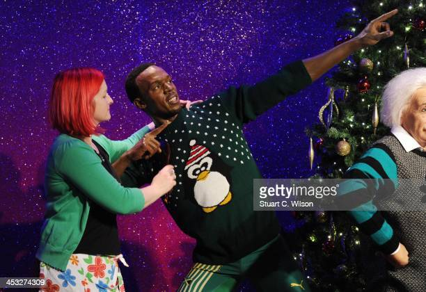 A waxwork of Usain Bolt is dressed in a Christmas jumper in support of the Save The Children campaign at Madame Tussauds on December 3 2013 in London...