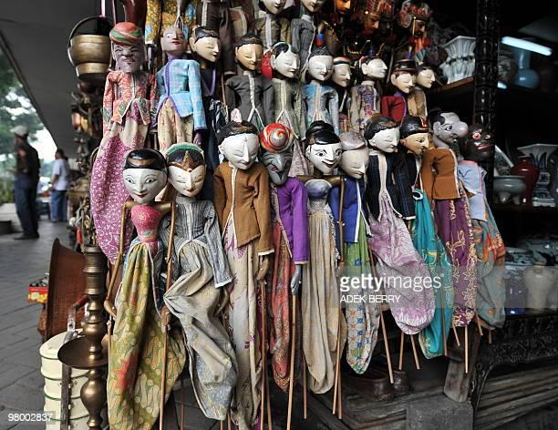 'Wayang golek' or golek puppets are displayed at the Jalan Surabaya antique market in Jakarta on March 23 2010 The antique market at Jalan Surabaya...