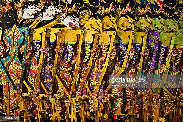 Wayang Kulit shadow puppets are seen during a theatre performance by the Great Master Dalang Ki Mantep Sudarsonoon August 10 2009 at his residence of...
