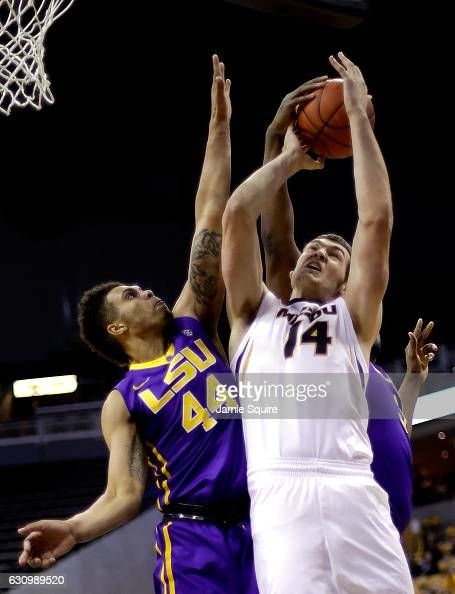 Wayde Sims of the LSU Tigers and Reed Nikko of the Missouri Tigers battle for a rebound during the game at Mizzou Arena on January 4 2017 in Columbia...