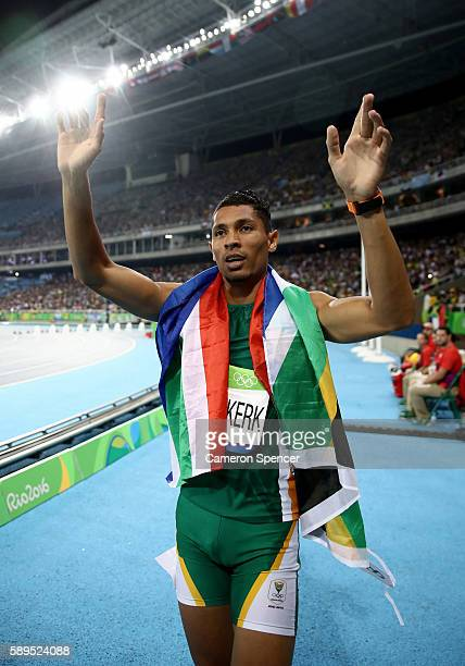 Wayde van Niekerk of South Africa celebrates after winning the Men's 400 meter final and setting a new world record of 4303 on Day 9 of the Rio 2016...