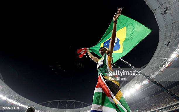 Wayde van Niekerk of South Africa celebrates after winning the Men's 400 meter final on Day 9 of the Rio 2016 Olympic Games at the Olympic Stadium on...