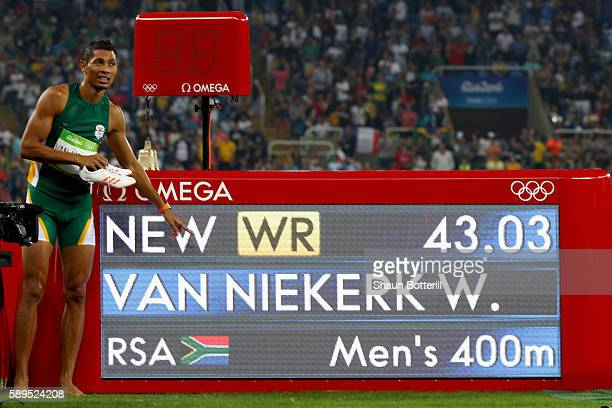 Wayde van Niekerk of South Africa celebrates placing first in the Men's 400m Final and setting a new world record of 4303 on Day 9 of the Rio 2016...