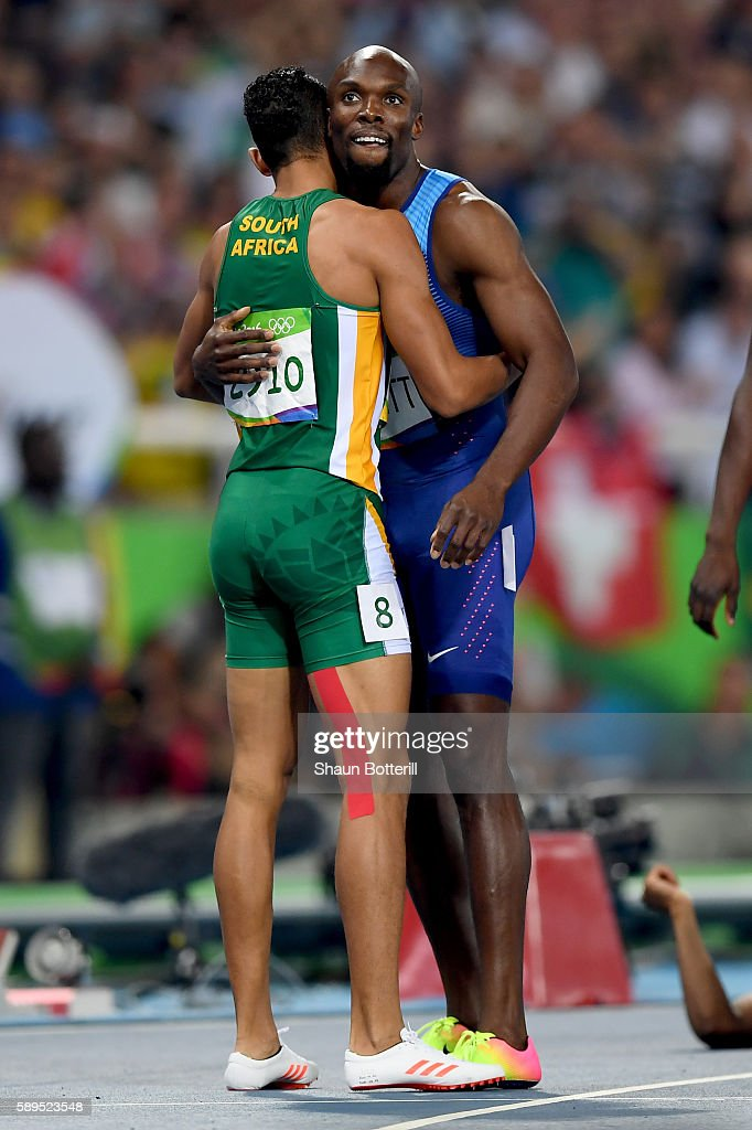Wayde van Niekerk of South Africa celebrates with Lashawn Merritt of the United States third after winning the Men's 400 meter final on Day 9 of the...