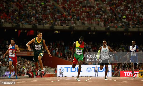 Wayde Van Niekerk of South Africa crosses the finish line to win gold ahead of Kirani James of Grenada in the Men's 400 metres final during day five...