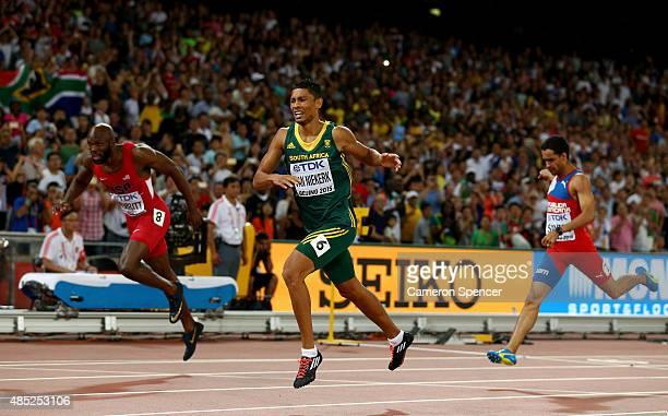 Wayde Van Niekerk of South Africa crosses the finish line to win gold ahead of Lashawn Merritt of the United States in the Men's 400 metres final...