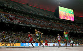 Wayde Van Niekerk of South Africa crosses the finish line to win gold ahead of Lashawn Merritt of the United States and Kirani James of Grenada in...