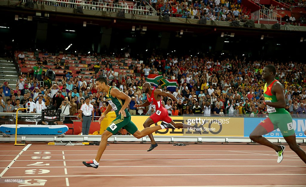 Wayde Van Niekerk of South Africa (L) crosses the finish line to win gold ahead of Lashawn Merritt of the United States (C) and Kirani James of Grenada (R) in the Men's 400 metres final during day five of the 15th IAAF World Athletics Championships Beijing 2015 at Beijing National Stadium on August 26, 2015 in Beijing, China.