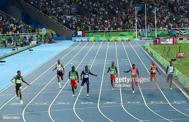 Wayde van Niekerk of South Africa crosses the finishline to win the Men's 400 meter final on Day 9 of the Rio 2016 Olympic Games at the Olympic...
