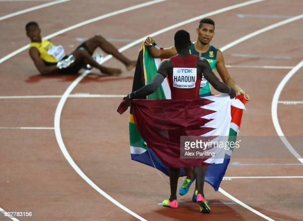 Wayde van Niekerk of South Africa gold celebrates with Abdalelah Haroun of Qatar bronze after the Men's 400 metres final during day five of the 16th...