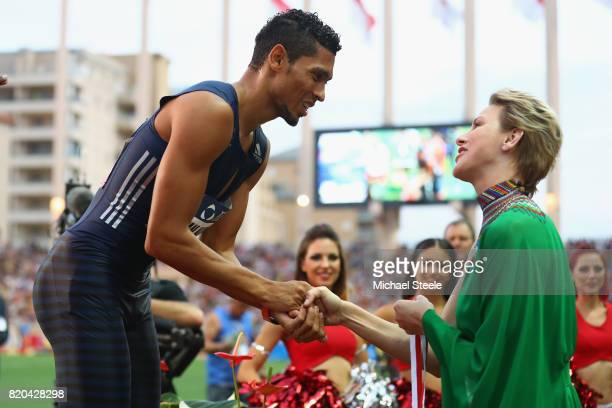 Wayde van Niekerk of South Africa is presented a medal by Prince Charlene of Monaco during the IAAF Diamond League Meeting Herculis on July 21 2017...