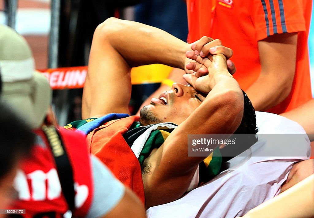 Wayde Van Niekerk of South Africa is stretchered off after winning gold in the Men's 400 metres final during day five of the 15th IAAF World Athletics Championships Beijing 2015 at Beijing National Stadium on August 26, 2015 in Beijing, China.