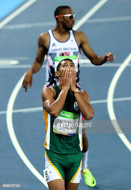 Wayde van Niekerk of South Africa reacts after winning the Men's 400 meter final on Day 9 of the Rio 2016 Olympic Games at the Olympic Stadium on...