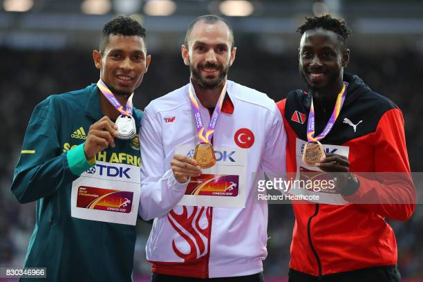 Wayde van Niekerk of South Africa silver Ramil Guliyev of Turkey gold and Jereem Richards of Trinidad and Tobago bronze pose with their medals for...