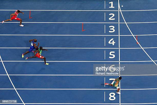 Wayde van Niekerk of South Africa wins the mens 400m Final ahead of Kirani James of Grenada and Lashawn Merritt of the United States on Day 9 of the...