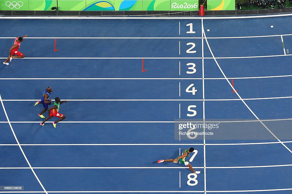 Wayde van Niekerk (R) of South Africa wins the mens 400m Final ahead of Kirani James of Grenada and Lashawn Merritt of the United States on Day 9 of the Rio 2016 Olympic Games at the Olympic Stadium on August 14, 2016 in Rio de Janeiro, Brazil.