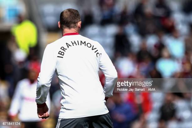 Wayen Rooney of Manchester United wears a shirt with Zlatan Ibrahimovic name on during warm up in support during the Premier League match between...