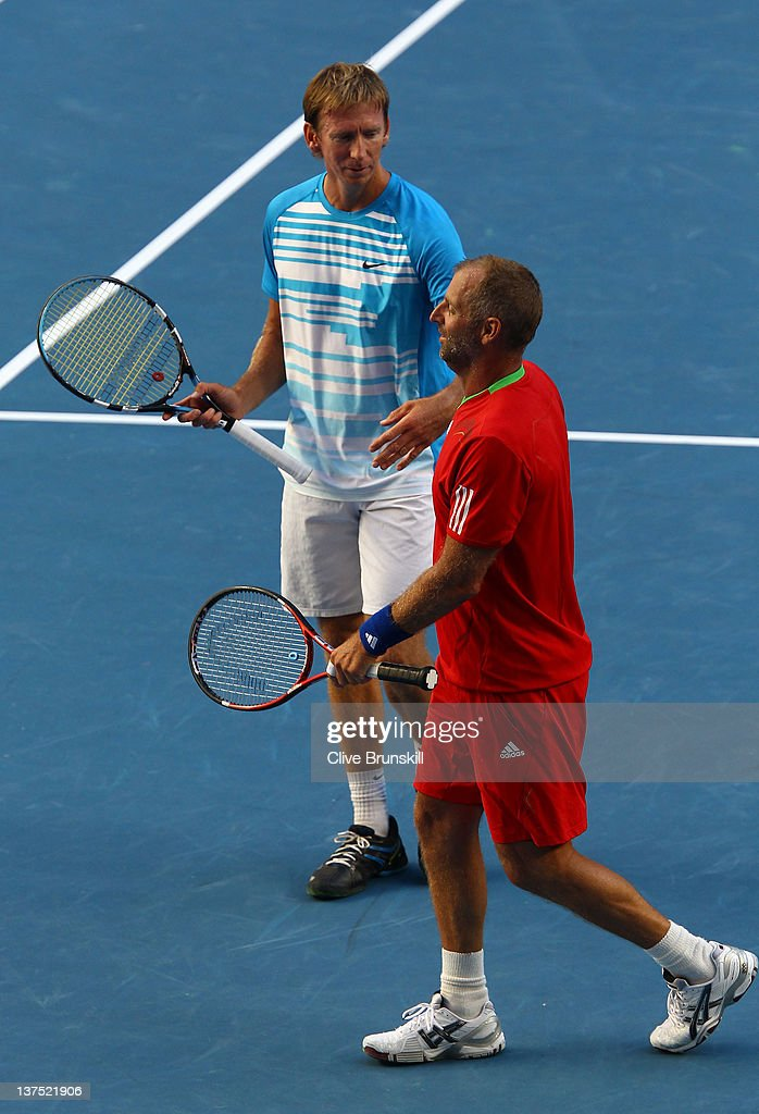 Wayne Arthurs of Australia and Thomas Muster of Austria compete in their first round legends doubles match against Jacco Eltingh and Paul Haarhuis of the Netherlands during day seven of the 2012 Australian Open at Melbourne Park on January 22, 2012 in Melbourne, Australia.