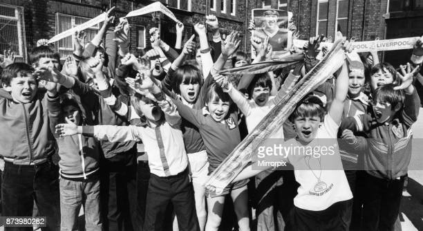 Wayne Ashe leads the cheers from the Loyal Liverpol fans at Anfield Junior Boys School ahead of their side's European Cup Final match against Club...