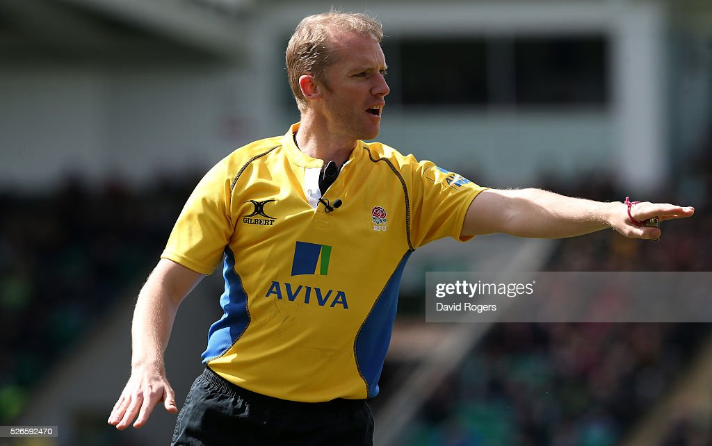 Wayne Barnes, the referee issues instructions during the Aviva Premiership match between Northampton Saints and Bath at Franklin's Gardens on April 30, 2016 in Northampton, England.