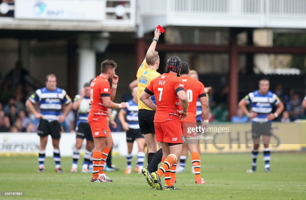 Wayne Barnes the referee, shows the red card to David Mele (not in pic) of Leicester during the Aviva Premiership match between Bath and Leicester Tigers at the Recreation Ground on September 20, 2014 in Bath, England.