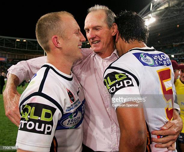 Wayne Bennett coach of the Broncos celebrates with captain Darren Lockyer and Karmichael Hunt after winning the NRL Grand Final between the Brisbane...