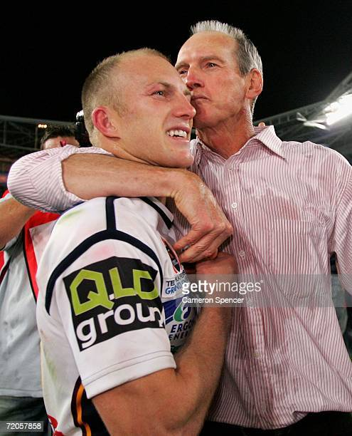 Wayne Bennett coach of the Broncos kisses team captain Darren Lockyer after winning the NRL Grand Final between the Brisbane Broncos and the...
