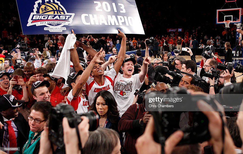 Wayne Blackshear (C) #20 of the Louisville Cardinals celebrates with teammates after they won 78-61 against the Syracuse Orange during the final of the Big East Men's Basketball Tournament at Madison Square Garden on March 16, 2013 in New York City.
