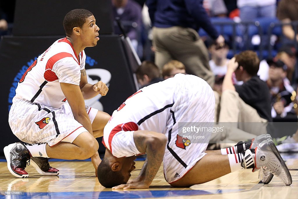 Wayne Blackshear #20 and Chane Behanan #21 of the Louisville Cardinals react after Kevin Ware #5 suffered a compound fracture to his leg in the first half against the Duke Blue Devils during the Midwest Regional Final round of the 2013 NCAA Men's Basketball Tournament at Lucas Oil Stadium on March 31, 2013 in Indianapolis, Indiana.