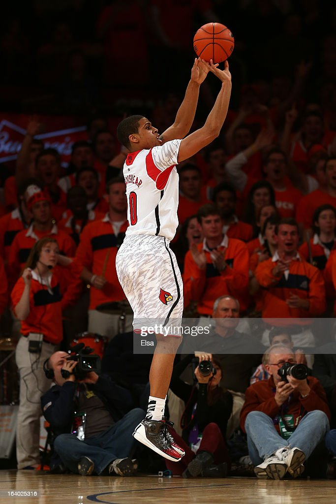Wayne Blackshear #20 of the Louisville Cardinals attempts a shot against the Syracuse Orange during the final of the Big East Men's Basketball Tournament at Madison Square Garden on March 16, 2013 in New York City.