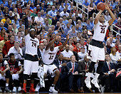 Wayne Blackshear of the Louisville Cardinals takes a threepoint shot in front of teammates Montrezl Harrell and Chinanu Onuaku against the North...