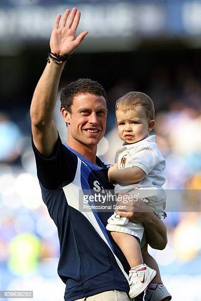 Wayne Bridge of Chelsea carries his son following the Barclays Premier League match between Chelsea and Bolton Wanderers at Stamford Bridge on May 11...